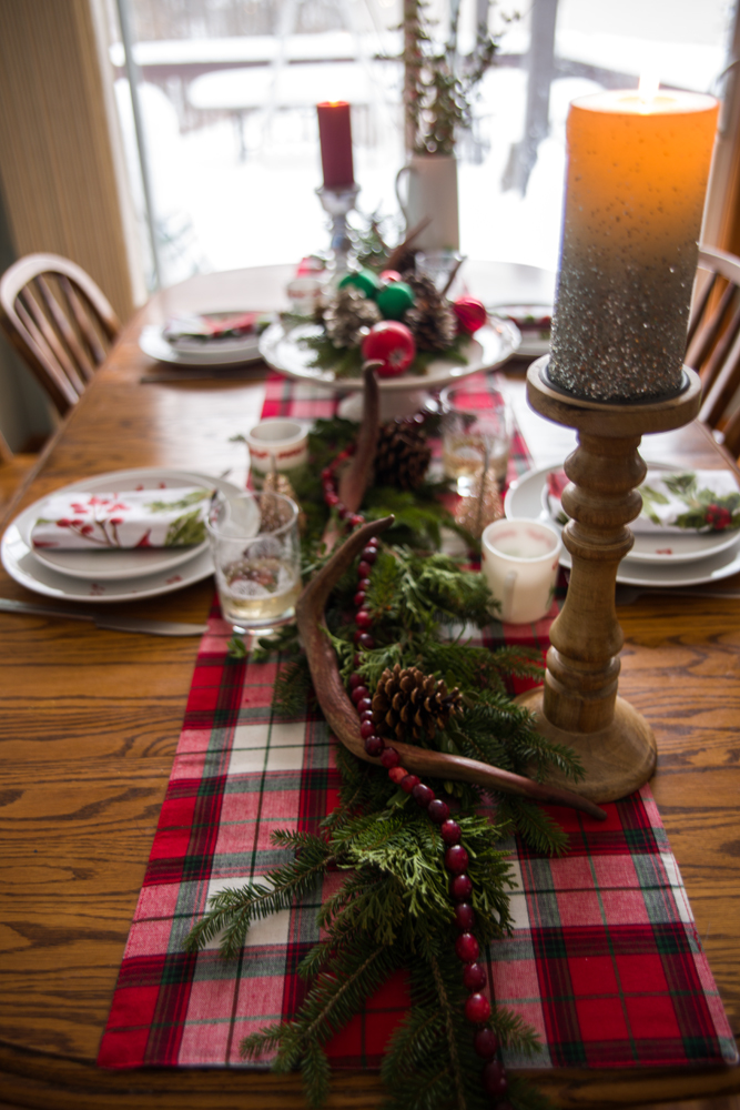 the plaid table runner glitter candle and mercury glass candle holder all came from tj maxx in past years the napkins cake stand and white pitcher are